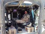 Brigadier-General Jennie Carignan, the commanding officer of Task Force Kandahar Engineer Regiment, takes a break in her Light Armoured Vehicle III in the District of Arghandab, Afghanistan in June 2010./Le Bgén Jennie Carignan, alors commandant du régiment de génie de la Force opérationnelle Kandahar, prend une pause dans son véhicule blindé léger III dans le district d'Arghandab, en Afghanistan, en juin 2010.