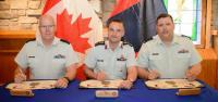CWO G. Simpkin, CD (Incoming CME Branch CWO), MGen J.S. Sirois, OMM, CD (CAF Chief Military Engineer) and CWO R.G. Swift, CD (Outgoing CME Branch CWO) signing the Branch CWO change of appointment certificate