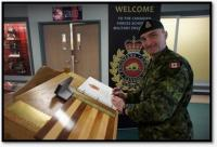 ADM(IE)'s Chief of Staff, MGen Sylvain Sirois, signs the guest book while attending Exercise UBIQUE at the Canadian Forces School of Military Engineering at CFB Gagetown.