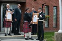 Mayor Randy Boyd (left) presents Lieutenant-Colonel Ryan Smith, Commanding Officer of 1 Combat Engineer Regiment (1 CER), with a scroll granting 1 CER the Freedom of the City in Bon Accord, Alberta on June 3, 2017. Photo by: Master Corporal Andrew Davis, 3rd Canadian Division Support Base Edmonton. © 2017 DND-MDN Canada