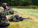 Assistant Range Safety Officer MCpl Wotherspoon supervises soldiers conducting PWT 2 qualifications at Vokes Range