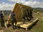 This 2010 photo shows members of the 74 Construction Troop from 4 Engineering Support Regiment building a structure for an orphanage in Haiti. DND photo.