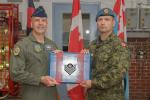 Brigadier General (USAF) Chad Manske promotes Sgt Nelson Nordstrom