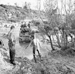 Sappers maintaining the ford across the Biferno south of Colle d'Anchise. A tank of the Ontario Regiment.