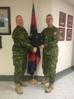 "Official handover from the outgoing RCE SM, CWO Croucher (Left) to the incoming RCE SM, CWO Dominic Gaudreau. Of particular note is the awesome circa 1987 Cbt Engr, old school, field cap hat badge that is permanently affixed to the ""Succession Planning Binder.""   Photo Credit: MCpl Marc Laliberte."