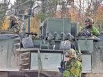 Photo 1 A Combat Engineer radios in the outcome of an enemy attack on a vehicle inspection point during Ex MATTAWA SAPPER, Nov 18