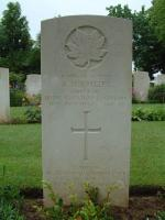"""A token of love and remembrance to one we will never forget"" - Sapper Switzer's headstone at Beny-sur-Mer Cemetery"