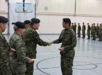 Cpl Ryan Bae, a member of 32 CER (Toronto), receiving the bursary cheque from Col D. Hobbs, Comd 32 Bde and LCol M. Clarry, CO 32 CER.