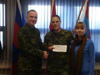 Leila-Ann Fife-McGinn daughter of WO McGinn (Winnipeg). Pictured are Leila-Ann's parents receiving the bursary cheque on behalf of their daughter from Maj S. Ivanko.