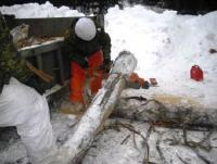 Sappers prepare logs to build barricades. Credit: Lt Kevin Madore