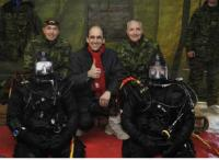 The divers of 5 CER: Capt Kilburn and Cpl Plourde; second row: Col Lafaut, Comd 5 CMBG; The Honourable Steven Blaney; BGen Giguère, Comd LFQA/JTF(E); standing: LCol Levasseur, CO 5 CER