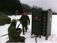 Cpl Kerr (electrical generating system tech) and Cpl Legendre (electrician), installing the power grid