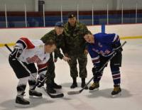 The ceremonial puck drop from left to right is MWO Marc Pacaud, Major Renald Nelson WCEO, MWO Daryl Foster and MCpl Frank McCafferty