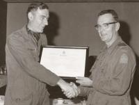 BGen St. Aubin presents Scroll to Marvin Johnston on promotion to CWO 1976