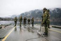 Army Reserve Combat Engineers assemble a Medium Floating Bridge on Cultus Lake near Chilliwack, B.C., during Exercise PALADIN RESPONSE 2013. This exercise allows participating soldiers to practice water and gap crossing tasks. These skills enable the Canadian Army to provide mobility support to provincial and local authorities, if required, in response to natural disasters. Photo credit: Bombardier Albert Law, Canadian Armed Forces
