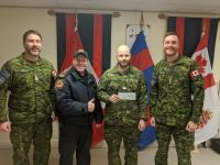 MCpl Richard accepting bursary cheque on behalf of Amy Bouchard (CWO Rondeau, Nicholas Bazinet-Deschamps, MCpl Richard and LCol Patry)