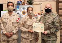 Cpl Jodi Payne, 8 Wing Trenton currently on Op IMPACT,  receives 386th Air Expeditionary Wing Chief Choice Award