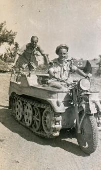 Bill Millhausen driving a German half-track with Major Reeman on back. Italy, June 1944.
