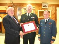 Col J.C. Benninger, 19 Wing Comox Commander and CWO K.P. Jones, CME Branch CWO, are presenting CWO D.N.F. Shavalier (Ret'd) with a CME Branch Commendation (certificate no 024) at the 192 CEF Aldergrove combined Mess on 15 December 2011.