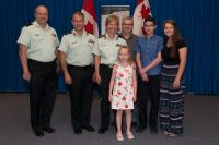 A ceremony was held at the Canadian Forces College in Toronto to promote Brigadier-General Jennie Carignan as the first female combat arms general officer in the Canadian Armed Forces. Present at the ceremony are (L to R) Chief Warrant Officer Robert McCann, Major-General Eric Tremblay, BGen Carignan, daughter Camille, husband Eric Lefrançois, son Ian and daughter Amelie./Une cérémonie a eu lieu hier au Collège des Forces canadiennes à Toronto pour souligner la promotion de la brigadier-général Jennie Carig
