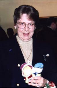 Mrs. Carol Isfeld with an Izzy doll // Mme Carol Isfeld avec une « poupée Izzy »
