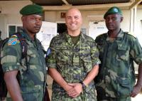 Senior Liaison Officer LCol JT Galuga was MONUSCO's representative to the Forces Armées de la République Démocratique du Congo (FARDC), the national Congolese army, from June to December, 2014. He is pictured with two FARDC officers in the town of Mavivi in North Kivu, DRC in July, 2014. Photo courtesy of LCol JT Galuga / Le Lcol JT Galuga, officier supérieur de liaison, était le représentant de la MONUSCO auprès des Forces armées de la République Démocratique du Congo (FARDC), l'armée congolaise nationale