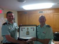 Col Basinger, Director RCE, presenting Maj Reynders with his certificate of service