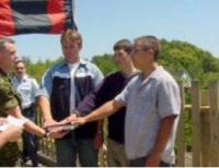 Three recruits being sworn in on the completed brigde: Mike Carver, Matt Ellis and Nathan MacLellan.  All three became members of 14 CES and two went on the RegF.