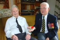 Mr. Russell Power presents French Legion of Honour to RCE veteran Mr. Bill Nicoll. (Photo: Cape Breton Post)