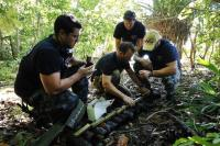 Royal Canadian Navy, Master Seaman Clearance Diver Shawn West (centre) calculates demolition charges required to clear unexploded ordnance in Russell Islands during Operation RENDER SAFE 2013 in Solomon Islands.