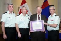 BGen K.D. McQuillan (CAF Chief Military Engineer), CWO K.A. Patterson (CME Branch CWO), Mr. Ken Holmes and BGen S.M. Irwin (Ret'd), CME Colonel Commandant. Presentation date: 7 May 2015//Bgén K.D. McQuillan (Ingénieur militaire en chef des FAC), Adjuc K.A. Patterson (Adjuc de la Branche du GMC), M. Ken Holmes et Bgén S.M. Irwin (à la retraite), colonel commandant du GMC. Date de la remise : le 7 mai 2015