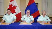 (from left to right)  CWO R.G. Swift, CD (Incoming CME Branch CWO), BGen K.D. McQuillan, OMM, CD (CAF Chief Military Engineer) and  CWO K.A. Patterson, MMM, CD (Outgoing CME Branch CWO) signing the Branch CWO change of appointment certificate//(de gauche à droite)  Adjuc R.G. Swift, CD (Adjuc du GMC entrant), Bgén K.D. McQuillan, OMM, CD (Ingénieur militaire en chef des FAC) et l'Adjuc K..A. Patterson, MMM, CD (Adjuc du GMC sortant) signant officiellement  le parchemin de passation des fonctions de l'Adjuc