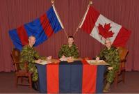 BGen R.W. DesLauriers, OMM, CD, BGen J.S. Sirois, and BGen S.M. Irwin signing the change of appointment certificate // Bgén R.W. DesLauriers, OMM, CD, Bgén J.S. Sirois, et Bgén S.M. Irwin signent le parchemin officiel de la passation
