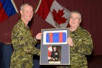 CME Branch CWO, CWO K.A. Patterson presents BGen DesLauriers with the Col Cmdt's pennant symbol of his past office // L'Adjuc de la Branche du GMC, Adjuc K.A. Patterson présente au Bgén DesLauriers le fanion du Colonel commandant à titre de symbole de son ancien poste