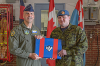 Brigadier General (USAF) Chad Manske promotes MCpl Ryan Moore