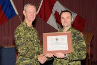 BGen J.S. Sirois presents BGen DesLauriers with a CME Branch Commendation