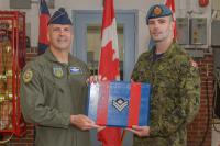 Brigadier General (USAF) Chad Manske promotes MCpl Brandon Terry