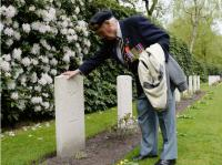 Canadian Second World War veteran Don Sommerville, 92, of Mississauga, Ont., visits the grave of friend Cpl. W.A. Martel following a commemorative ceremony at Holten Canadian War Cemetery in Holten, Netherlands, on Monday, May 4, 2015, on the eve of the 70th anniversary of the Liberation of the Netherlands. Photo by Sean Kilpatrick/ Canadian Press
