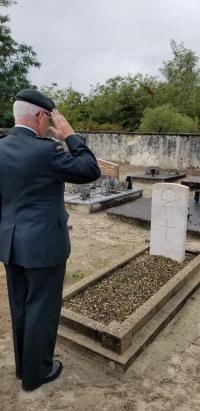 BGen Irwin saluting the grave of Pvt Herbert in Lesperon