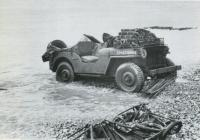 'Blitz Buggy' jeep loaded with high explosives for the sappers to breach the Dieppe wall. Most of the engineers were killed or wounded before they got to that point.  Note the chespaling under the wheels. (Dieppe: Tragedy to Triumph, BGen Denis Whitaker)