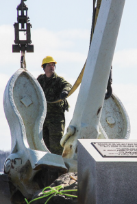 Members of 144 and 143 Construction Engineering Flight, based out of Pictou and Bridgewater, conducted the repair work on the Bonaventure Memorial, and used a crane on March 19 to connect the anchor to the newly built metal mounts.  Photo: Ryan Melanson, Trident