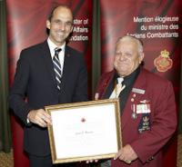 "2Lt  Jeston V. ""Buddy"" Brennan (Ret'd) receiving a commendation from the Minister of Veterans Affairs"