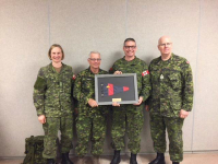 Col Derek Basinger receives the Director RCE framed pennant from Colonel Commandant CME BGen (R) Steve Irwin. From left to right Cmdt CFSME and Deputy Director RCE, LCol Barb Honig, Col Cmdt CME BGen (R) Steve Irwin, Col Basinger and CME CWO, CWO Glenn Simpkin. Photo taken by Maj J. Boddy OC Field Engineer Training Squadron CFSME