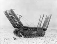 The Churchill Arc Bridge was driven into the gap, using the tank chassis as a pier.