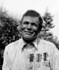 Mr. Glode with his medals (Distinguished Conduct Medal, British War Medal, Victory Medal) taken by Clara Dennis
