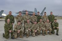 American Fire Service and RCAF Fire service Platoon Chiefs and crews after doing AC familiarization training on an CF-18