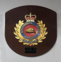 Carving of the engineer cap badge by Edgar that he donated to CFSME and currently hangs in the School CWO's office.