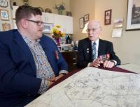 George Fouchard, right, goes over a campaign map with Nathan Kehler at Fouchard's apartment in Ottawa April 23, 2019. (Andrew LeeCBC News)