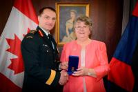 "MGen JS Sirois, Chief Engineer, presents the ""Sovereign's Medal for Volunteers"" to Mrs Shirley O'Connell 25 April 2019"