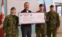 Cpl Jennifer Fraser, Maj Alexandre Landry, OC RP Ops Det Kingston, Maj (Ret'd) Chris Catry, and receiving the cheque on behalf of Soldier On / Sans Limites, MWO Ed Butt, Sgt-Maj RP Ops Det Kingston.